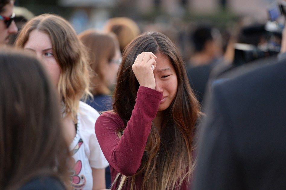 A student weeps during a candlelight vigil on Sunday for the victims of a killing spree in Isla Vista, on the University of California, Santa Barbara campus. Robyn Beck /AFP/Getty Images
