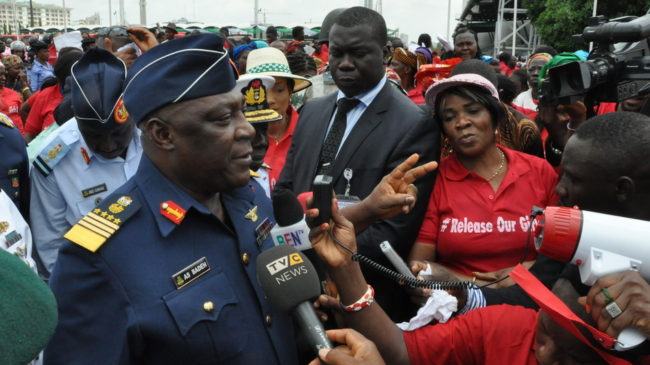 Nigeria's chief of defense staff Air Marshal Alex S. Badeh speaks during a demonstration in Abuja calling for the rescue of girls kidnapped from their school in Chibok. Badeh says the government knows where the girls are — but that a rescue attempt would endanger their lives. Gbenga Olamikan/AP