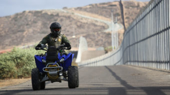 A new report lists more than 800 complaints made against U.S. Border Patrol agents; most include physical abuse. Here, an agent patrols the U.S.-Mexico border fence at in San Diego, Calif., last year. John Moore/Getty Images