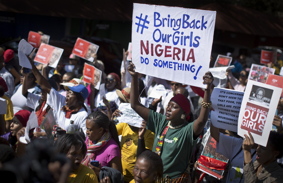 The effort to find hundreds of abducted Nigerian schoolgirls has gone international — and so has anger over the mass kidnapping, as evidenced by this protest Thursday in South Africa. Retired Gen. Carter Ham says there's still a chance for the U.S. to help. Ben Curtis/AP