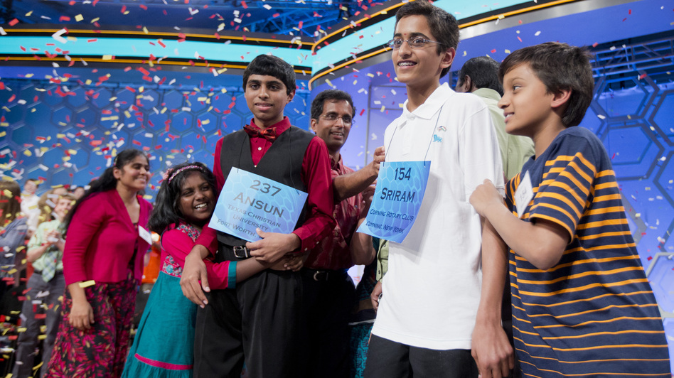 Ansun Sujoe, of Fort Worth, Texas, and Sriram Hathwar, of Painted Post, N.Y., were named co-champions of the 2014 Scripps National Spelling Bee Thursday night. Their siblings helped them celebrate the first shared title since 1952. Manuel Balce Ceneta/AP