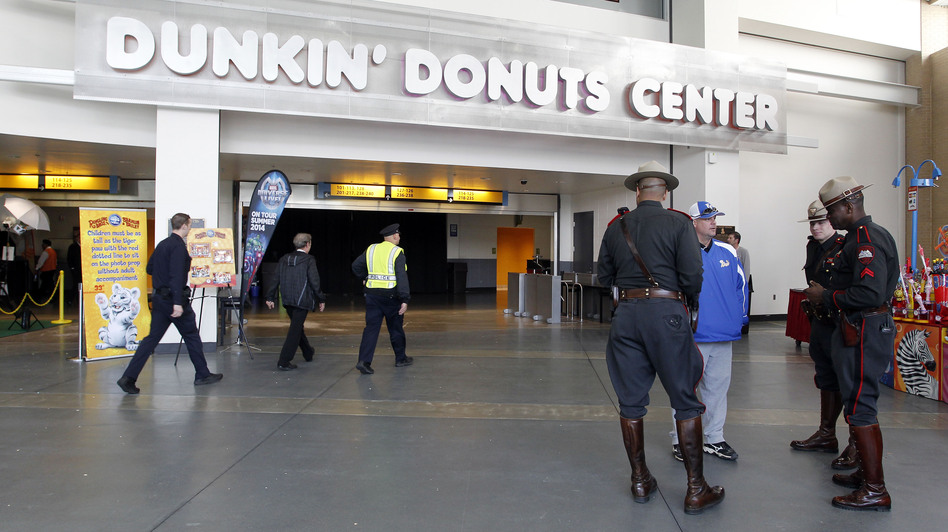 Rhode Island state troopers and Providence police stand in the lobby of the Dunkin' Donuts Center after an accident during the Ringling Bros. and Barnum & Bailey Circus performance Sunday. Stew Milne/AP