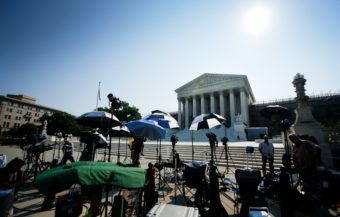 Members of the media camp outside the U.S. Supreme Court in June of 2013. Jim Watson /AFP/Getty Images