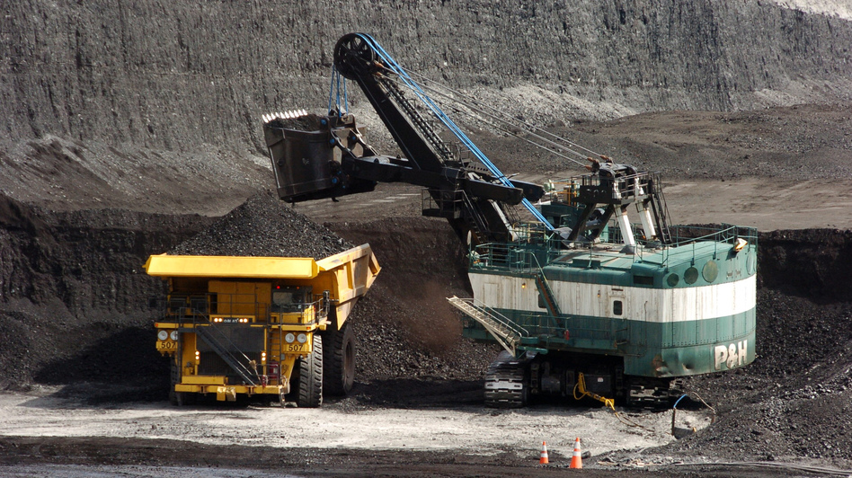 Stanford University's trustees says the school will rid itself of any investments it has made in coal-producing companies. A 2013 file photo shows coal being loaded onto a truck at a mine near Decker, Montana. Matthew Brown/AP