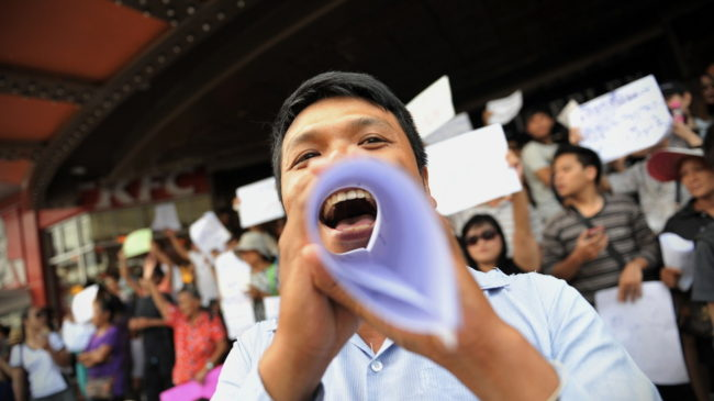 Protesters shout slogans during an anti-coup rally on Saturday in Bangkok, Thailand. Rufus Cox/Getty Images