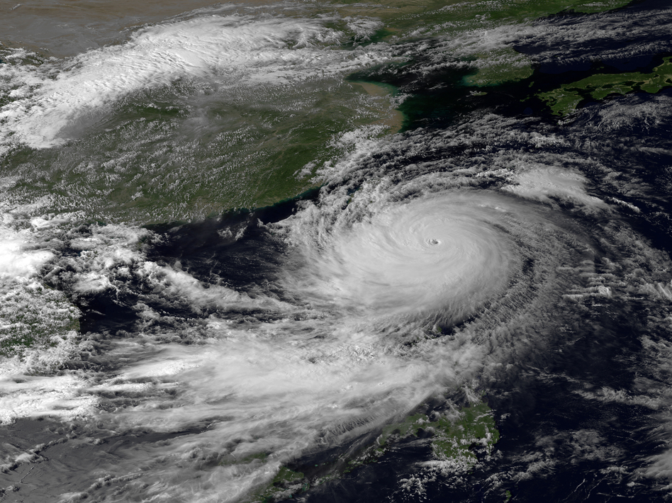 A NOAA image taken by the Japan Meteorological Agency in September shows Typhoon Usagi. A new study says that such tropical cyclones are reaching peak intensity farther away from the equator. NOAA/JMA/AP
