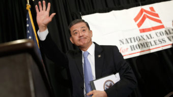 Secretary of Veterans Affairs Eric Shinseki waves after addressing the National Coalition for Homeless Veterans in Washington Friday. Shinseki is under bipartisan pressure to resign amid problems with the agency's medical care system. Win McNamee/Getty Images