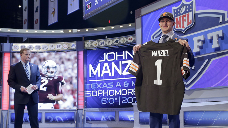 Texas A&M quarterback Johnny Manziel poses for photos after being selected by the Cleveland Browns as the 22nd pick in the first round of the 2014 NFL Draft, Thursday. Craig Ruttle/AP