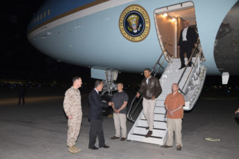 President Barack Obama is greeted by U.S. Ambassador to Afghanistan James Cunningham and Marine General Joseph Dunford, commander of the U.S.-led International Security Assistance Force (ISAF), as he steps off Air Force One at Bagram Air Field in Afghanistan. Evan Vucci/AP
