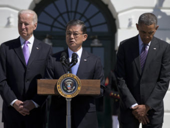 Veterans Affairs Secretary Eric Shinseki, flanked by President Obama and Vice President Biden, at the White House last month. Carolyn Kaster/AP