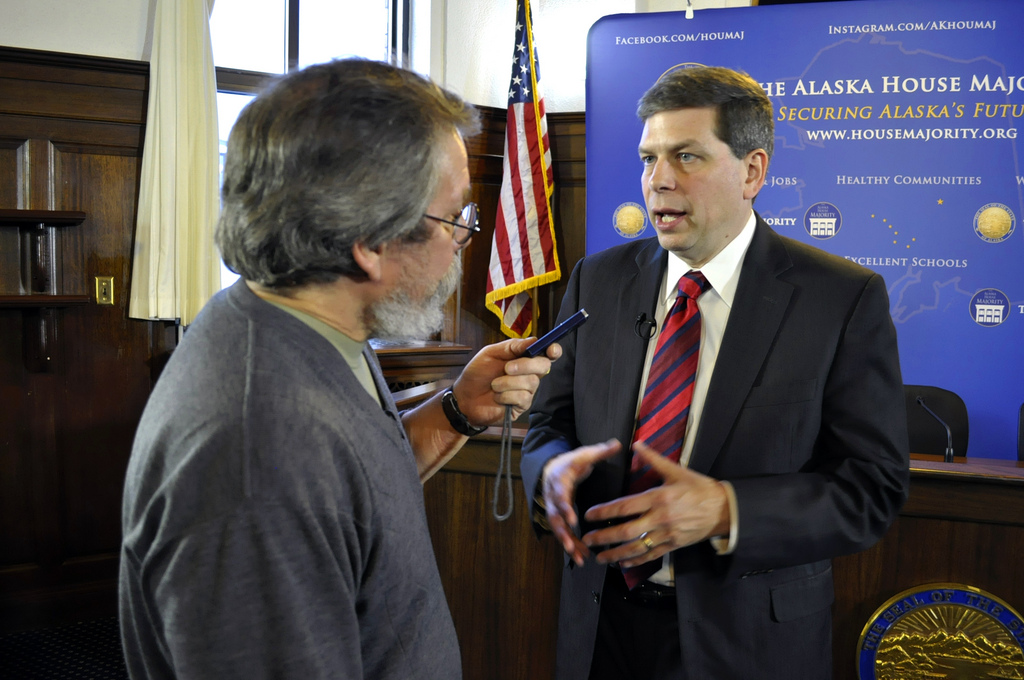 Reporter Bob Tkacz interviews U.S. Sen. Mark Begich following the senator's annual address to the Alaska Legislature, March 3, 2014. (Photo by Skip Gray/Gavel Alaska)