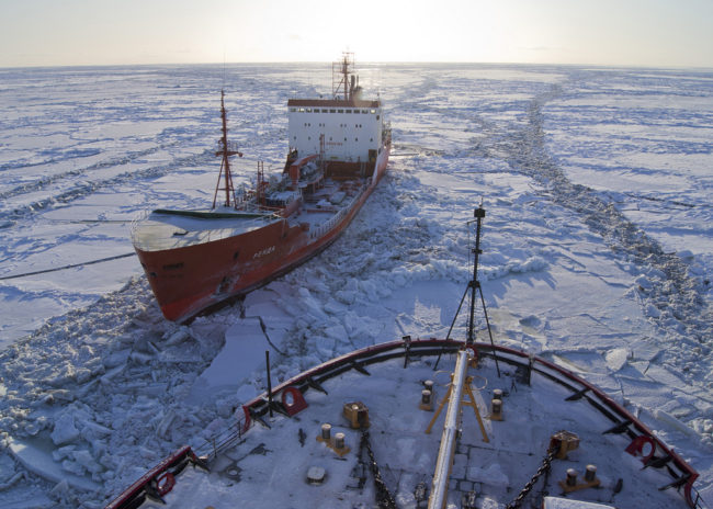 The Russian-flagged tanker Renda, carrying more than 1.3 million gallons of fuel, sits in the ice while the Coast Guard Cutter Healy crew breaks the ice around the tanker approximately 19 miles northwest of Nunivak Island Jan. 6, 2012. (Photo courtesy U.S. Coast Guard Cutter Healy)