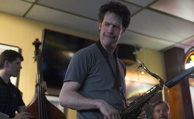 A man holding a saxophone