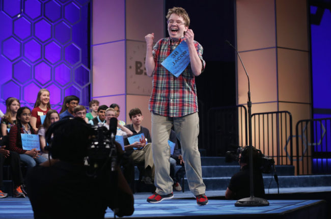 Speller Jacob Daniel Williamson of Cape Coral, Fla., reacts after he correctly spelled a word during round five of the 2014 Scripps National Spelling Bee competition Thursday. He made it to the finals — and won fans with his enthusiasm. Alex Wong/Getty Images