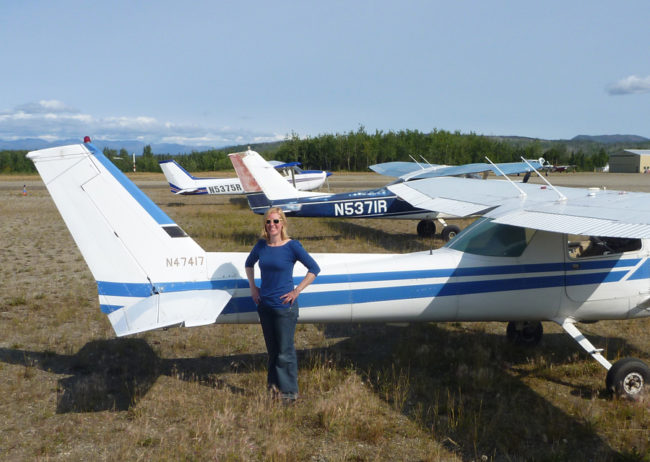 Jessica Cherry in Bettles, Alaska, posing with the three planes she used for her private, instrument and commercial flight training. (Photo courtesy Jessica Cherry)
