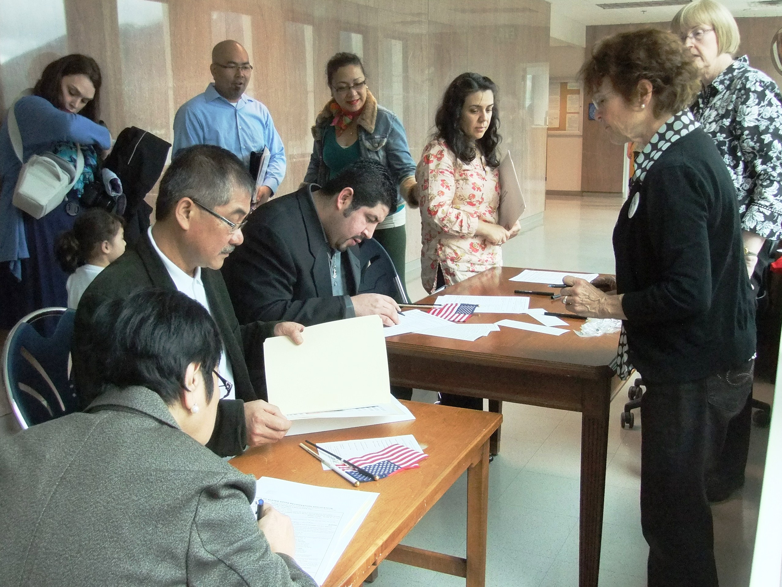 The new American citizens registered to vote before leaving the courthouse. (Photo by Rosemarie Alexander/KTOO)