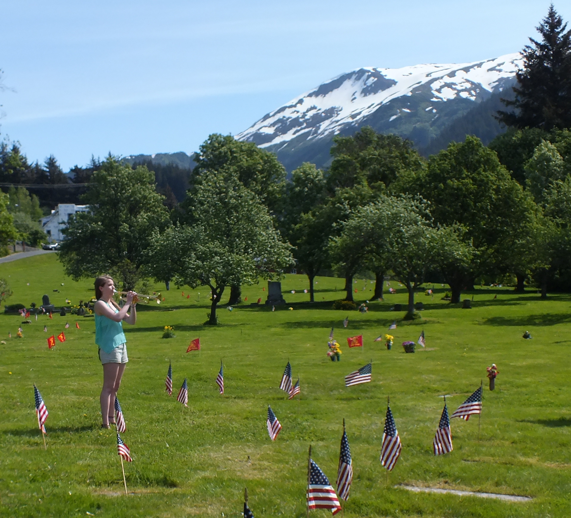 Memorial Day observances at Evergreen Cemetery featured the playing of  Taps. (Photo by Matt Miller/KTOO)