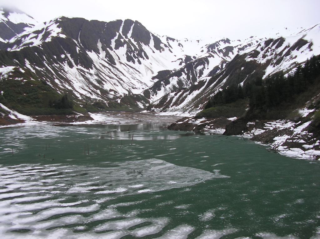 Salmon Creek reservoir, May 26, 2009.  Water level is within a foot or two of the current elevation, but there's more ice on the lake and snow on the hillsides. (Photo courtesy Scott Willis/ AEL&P)