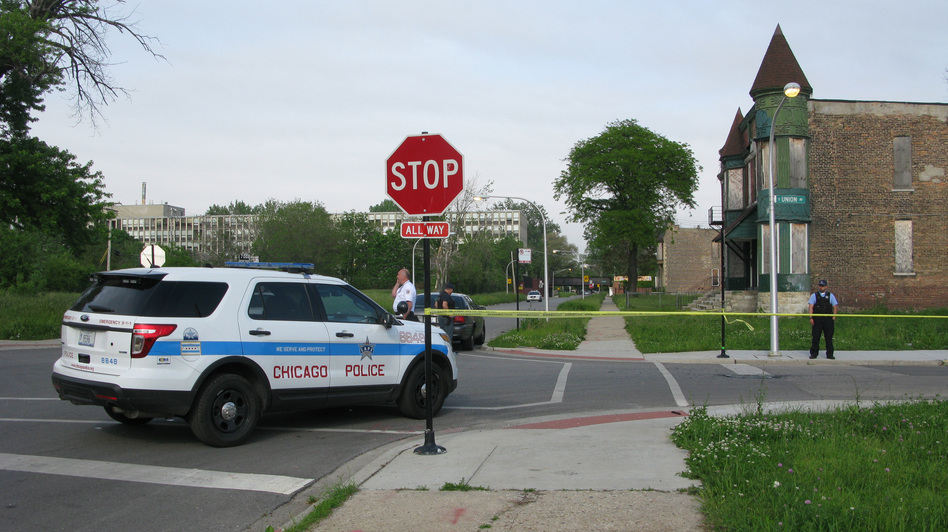 Police cordon off the area around a shooting in Chicago Wednesday. The violence broke out down the street from where an interview about guns in the city was being conducted. David Schaper /NPR