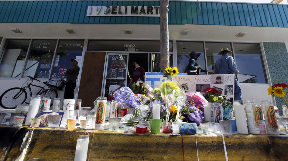 A makeshift memorial sits in front of IV Deli Mart, where part of Friday night's mass shooting took place in the Isla Vista, Calif., community. The parents of Elliot Rodger, accused of killing six people, were reportedly rushing to try to stop their son when they heard about the violence. Chris Carlson/AP