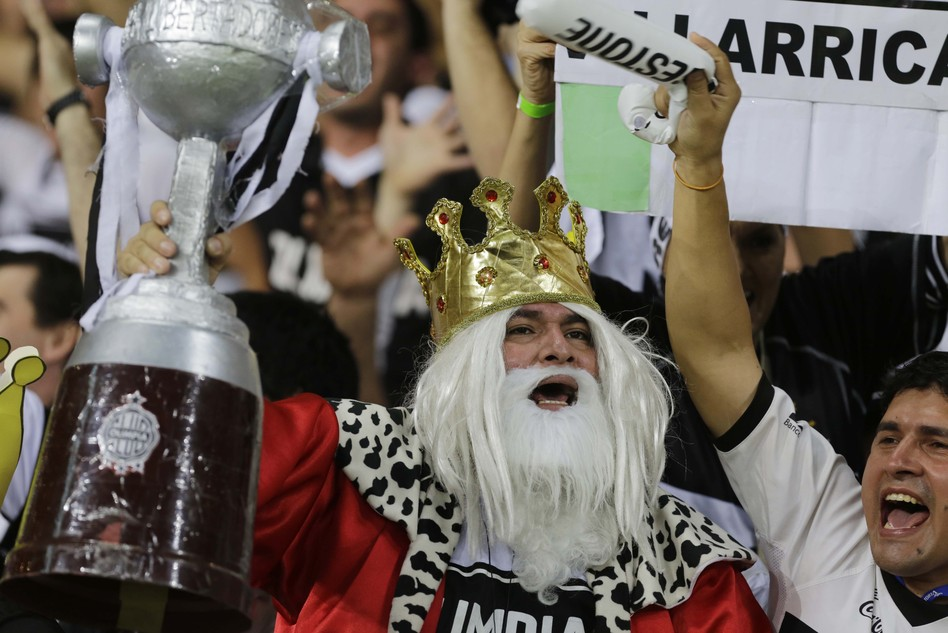 The kings of positive feelings: Paraguay's citizens were found to have the most positive things to say about their lives, according to a recent poll. Here, soccer fans cheer for Paraguay's Olimpia team last year. Nelson Antoine/AP