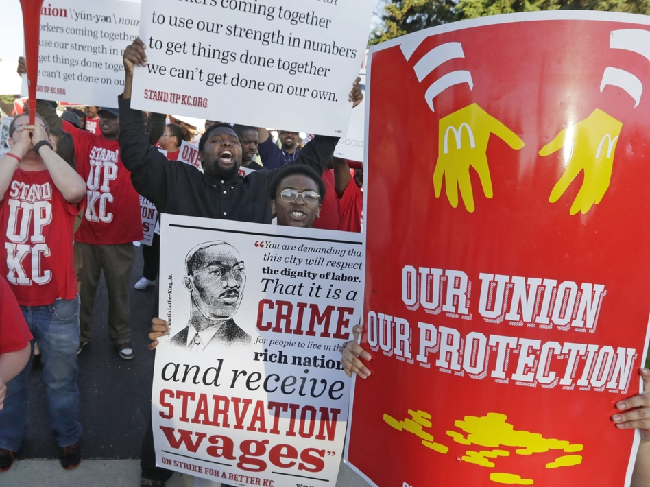 Hundreds of workers, organizers and supporters gather outside McDonald's Corp. on Thursday, in Oak Brook, Ill., calling for $15 an hour and the right to unionize. M. Spencer Green/AP
