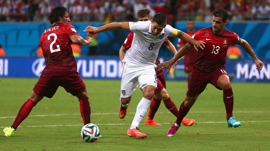 Clint Dempsey of the United States is challenged by Portugal's Bruno Alves (left) and Ricardo Costa during the 2014 FIFA World Cup Group G match Sunday in Brazil. Warren Little/Getty Images
