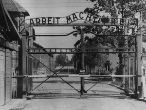 "The Nazi concentration camp Auschwitz I in Poland, circa 1945. Writing over the gate reads ""Arbeit macht frei"" (Work Sets You Free). Johann Breyer has admitted to working as a guard at the camp but says he only supervised work parties outside the gates. Uncredited/AP"