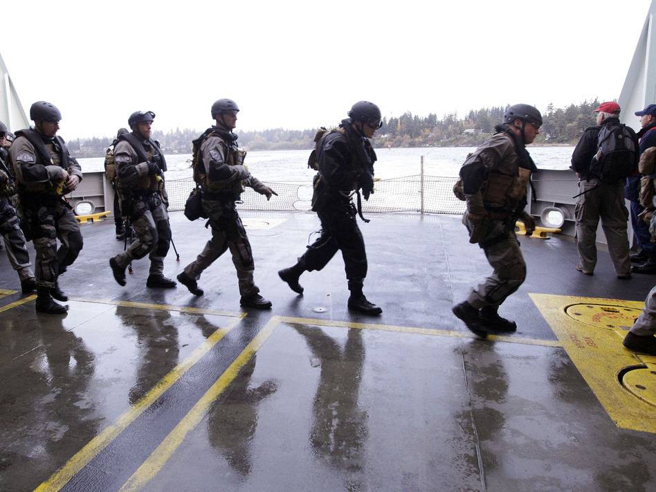 During a drill, SWAT team members prepare to secure a ship in Bainbridge Island, Wash. Elaine Thompson/AP