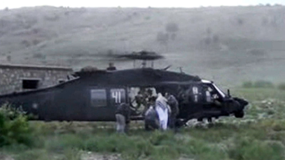 A video released by the Taliban shows Sgt. Bowe Bergdahl being bundled into a U.S. helicopter in eastern Afghanistan on Saturday. AP