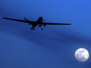 An unmanned U.S. Predator drone flies over Kandahar Air Field, southern Afghanistan, on Jan. 31, 2010. U.S. drone strikes killed at least 13 people in two separate strikes Wednesday and Thursday in Pakistan's tribal area. Kirsty Wigglesworth/AP