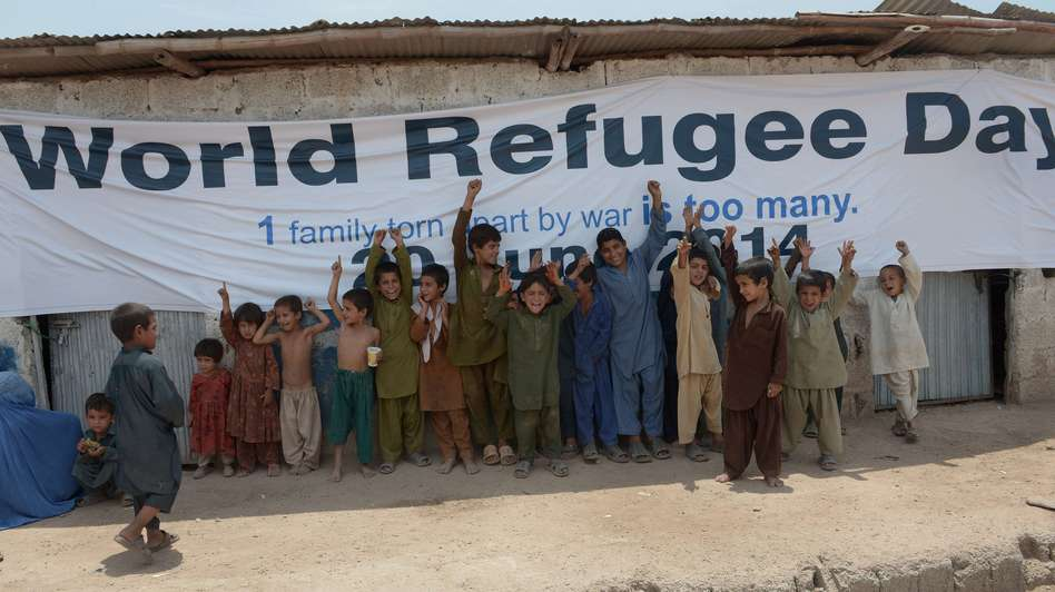 Afghan children gather at a special medical camp set up by UNHCR to mark World Refugees Day in Islamabad Friday. The UN agency says there were 51.2 million displaced people at the end of 2013, 6 million higher than the previous year. Farooq Naeem/AFP/Getty Images