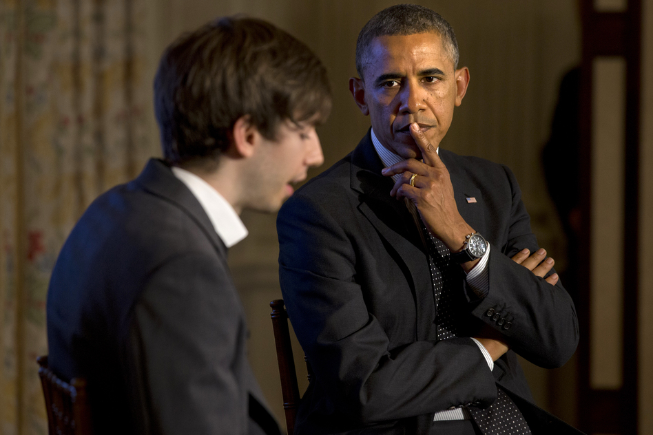 President Obama listens to a question read by Tumblr founder and CEO David Karp during a Tumblr forum Tuesday. Jacquelyn Martin/AP