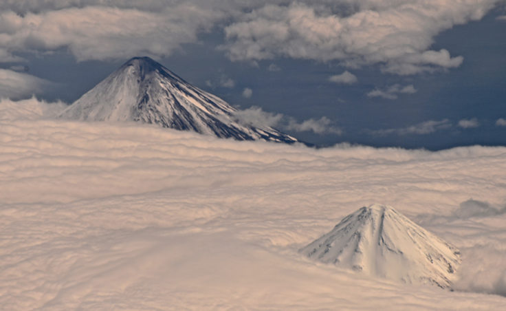 Cleveland and Carlisle volcanos as seen from an Alaska Airlines 737 enroute to Adak. (Photo courtesy AVO/Cyrus Read)