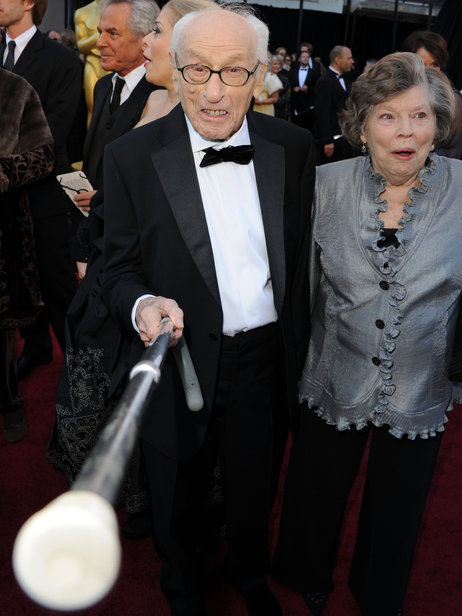 Eli Wallach arrives at the 2011 Academy Awards with his wife, Anne Jackson. Wallach died Tuesday. Jason Merritt/Getty Images