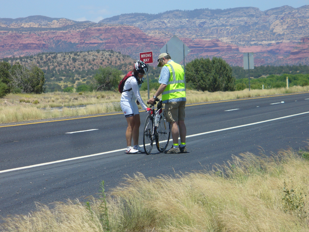 Janice Sheufelt and her husband Jim check on her bike during the 2013 Race Across America. After setting a record with racing partner Joel Sothern in a mixed gender team division last year, Sheufelt won RAAM's solo female under 50 division this year. (Photo courtesy Peter Apathy)