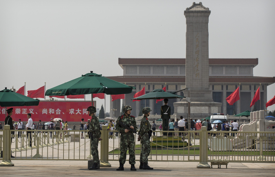 Chinese paramilitary police stand guard in Tiananmen Square in Beijing on June 4, the 25th anniversary of a violent crackdown on protesters by Chinese troops. Kevin Frayer/Getty Images