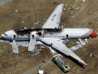 Asiana Flight 214 crashed at San Francisco International Airport in July 2013. The NTSB concluded Tuesday that an over-reliance on automated systems contributed to the crash. Marcio Jose Sanchez/AP