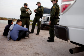 Young migrants seen apprehended by the Border Patrol near the Rio Grande in Hidalgo, TX, earlier this year. The next stop for many is either a detention center or deportation. Kainaz Amaria/NPR