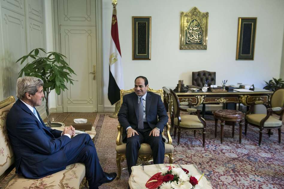 Egyptian President Abdel-Fattah el-Sissi and U.S. Secretary of State John Kerry talk before a meeting at the Presidential Palace on Sunday in Cairo. Brendan Smialowski/AFP/Getty Images