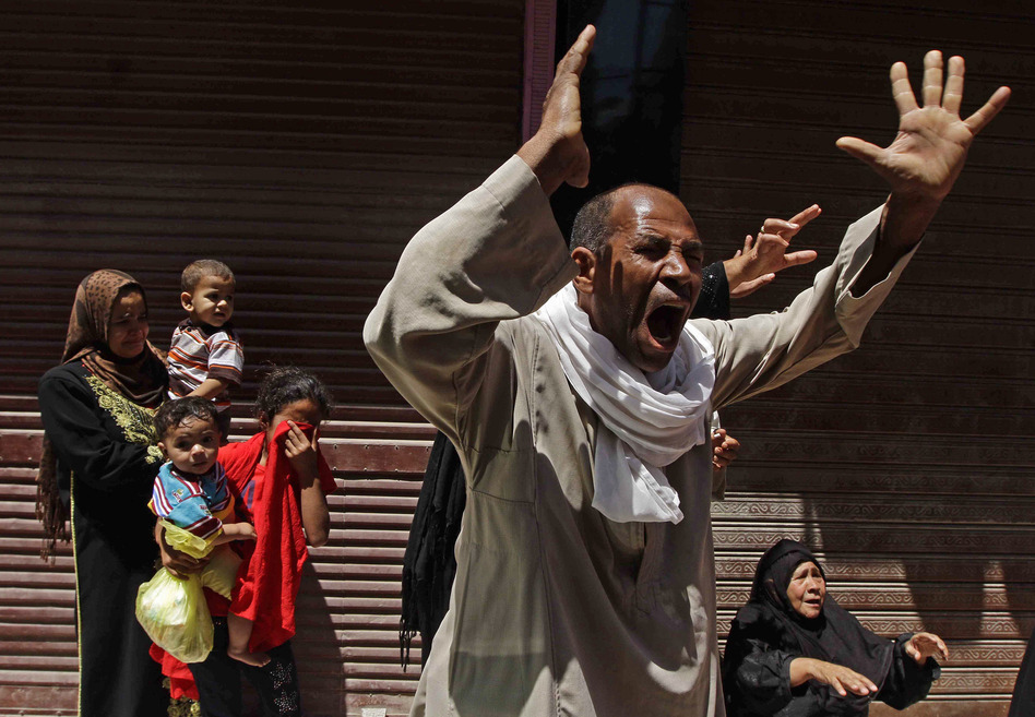 Relatives of a Muslim Brotherhood member who was sentenced to death react to the verdict outside a courtroom in Minya, Egypt, on Saturday. Ravy Shaker/AP