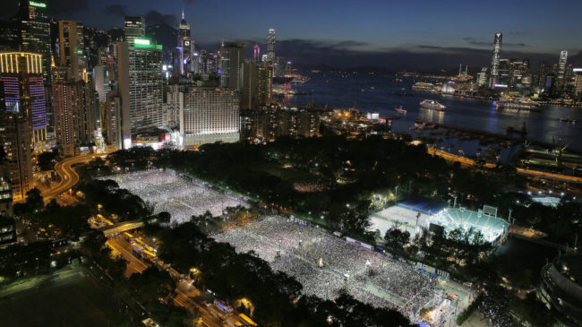 Tens of thousands of people attend a candlelight vigil at Victoria Park in Hong Kong Wednesday to mark the 25th anniversary of the Chinese military crackdown on pro-democracy protests in Beijing. Vincent Yu/AP