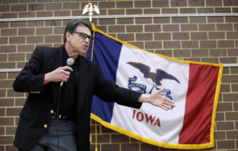 Texas Gov. Rick Perry speaks to local party activists on Saturday in Algona, Iowa. After his presidential bid crashed in 2012, Iowans now have to decide whether to give Perry another spin. Charlie Neibergall/AP