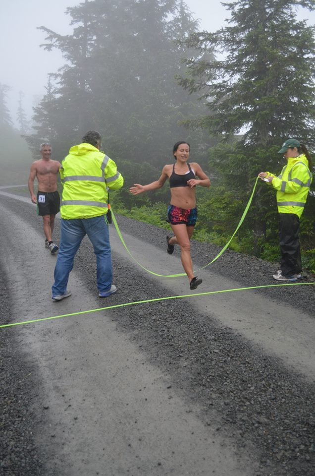 Women's champion Tasha Folsom crosses the finish line on Harbor Mt. (Photo courtesy Sitka Alpine Adventure)