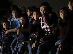 Immigrants from Honduras and El Salvador who crossed the U.S.-Mexico border illegally are stopped in Granjeno, Texas, on June 25. President Obama asked Congress this week for $3.7 billion to cope with thousands of minors from Central America who are illegally crossing the U.S. border. Eric Gay/AP