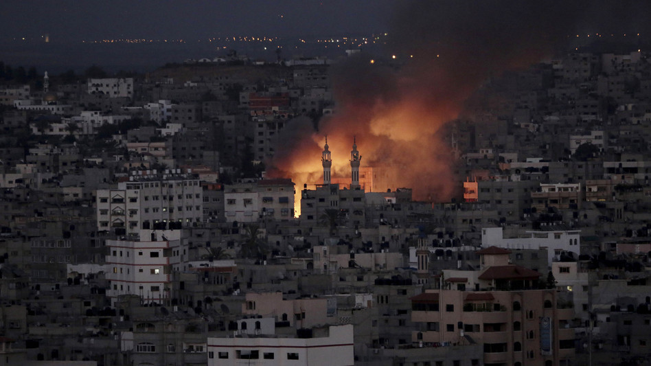 Smoke and flames from an Israeli strike rise over Gaza City on Thursday. Adel Hana/AP