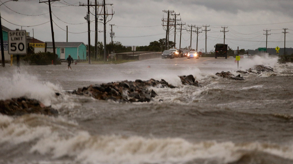 Hurricane Arthur brought strong winds and heavy surf to Highway 64 in Nags Head, N.C., on Thursday. Mark Wilson/Getty Images