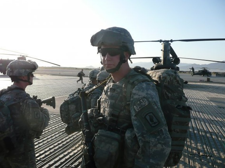 Sgt. Ryan Pitts waits for a flight at Bagram Airfield, Afghanistan. U.S. Army