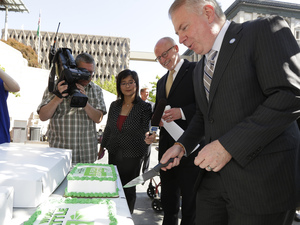 Seattle Mayor Ed Murray (right) and Seattle City Council President Tim Burgess cut a cake to celebrate city's raised minimum wage. Ted S. Warren/AP