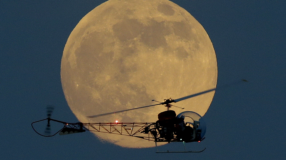 The moon appeared bigger and brighter when it went supermoon on June 23, 2013 — especially when it was seen next to objects on the horizon, such as the helicopter from the original Batman television show at the New Jersey State Fair last year. Julio Cortez/AP